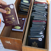 The collection of voyagers' submitted passports from various countries on Embarkation day for the Semester at Sea Spring 2014 Voyage, in Ensenada, Mexico.