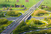 Nederland, Zuid-Holland, Gorinchem, 09-05-2013; knooppunt Gorinchem, kruising rijksweg A27 met A15 (vlnr). Foto van  het klaverblad in de richting Utrecht, langs de A27.<br /> Junction motorway A27 with A15, Cloverleaf Gorinchem<br /> luchtfoto (toeslag op standard tarieven)<br /> aerial photo (additional fee required)<br /> copyright foto/photo Siebe Swart