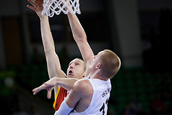 Quentin Serron #10 of Belgium and Robin Benzing #12 of Germany during basketball match between National teams of Germany and Belgium at Day 2 of Eurobasket 2013 on September 5, 2013 in Tivoli Hall, Ljubljana, Slovenia. (Photo By Urban Urbanc / Sportida.com)