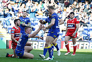 Jack Hughes (L) of Warrington Wolves celebrates scoring the 2nd try against Hull Kingston Rovers with team mate Kevin Brown (R) during the Betfred Super League match at the Halliwell Jones Stadium, Warrington<br /> Picture by Stephen Gaunt/Focus Images Ltd +447904 833202<br /> 14/04/2018