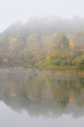 On an autumn morning, fog envelops Indigo Lake, located in Cuyahoga Valley National Park, Ohio.
