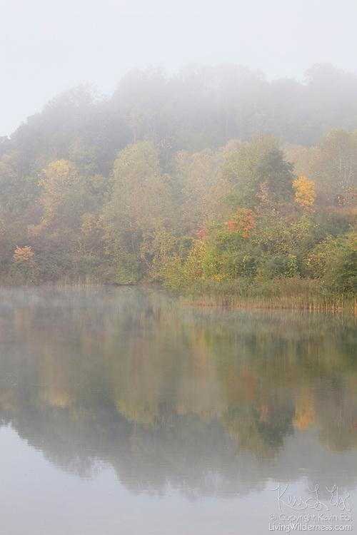 On an autumn morning, fog envelops Indigo Lake, located in Cuyahoga Valley National Park, Ohio.