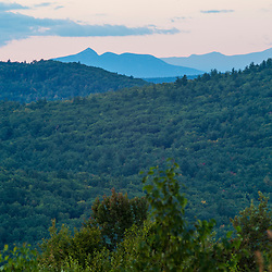 The view from Birch Ridge in New Durham, New Hampshire. Mount Chocorua (left) and Mount Washington in the distance.