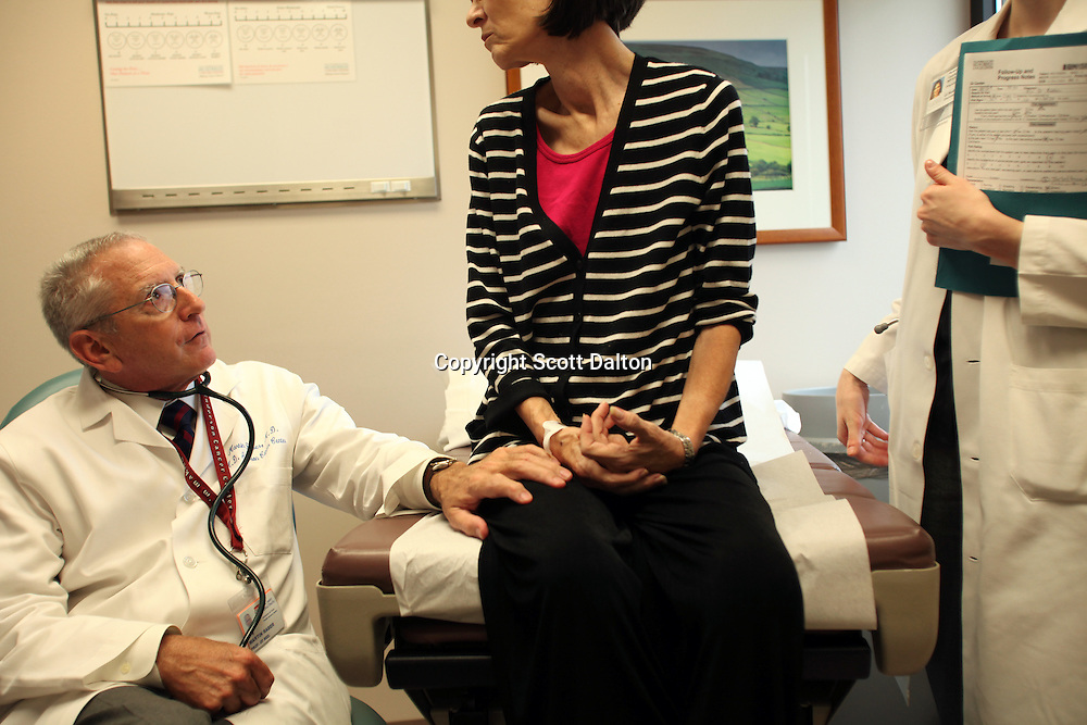 Dr. Martin Raber sees one of his patients at the MD Anderson Cancer Center in Houston, TX on October 1, 2009. Dr. Raber was diagnosed with lymphoma, he was treated at his own hospital, now a cancer survivor he provides a unique perspective for his patients drawn from his own experiences as a patient and a cancer survivor. (Photo/Scott Dalton)