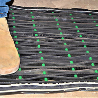 A finisihed door mat made by Cornfields Chapter maintenance workers Bob Yazzie, Vernell Joe and office assistant Aurey Yazzie from an old truck tire, rubber spacers and heavy-duty steel rods.