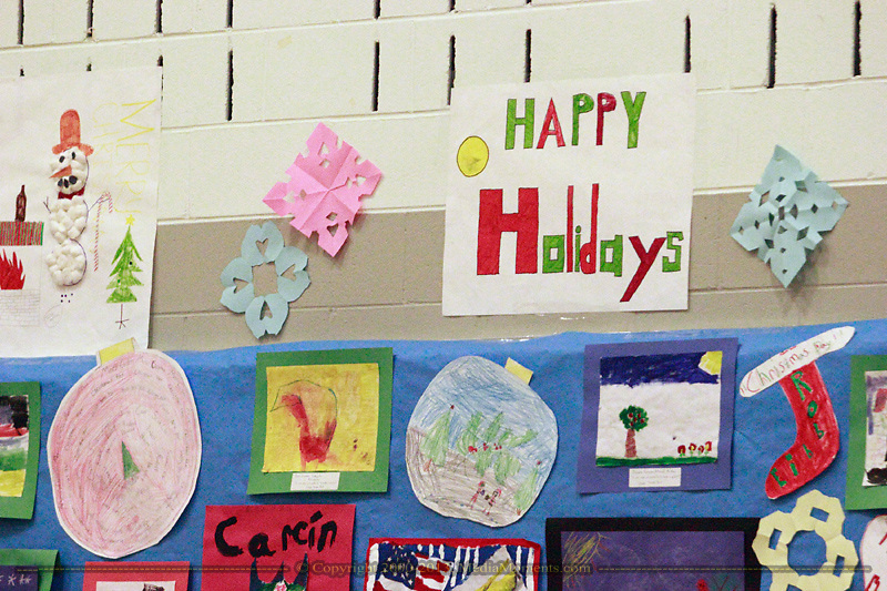 Some of the student artwork on the walls in the gymnasium during the 'We Will Jingle!' arts concert at Cleveland PK-8 school in Dayton, Wednesday, December 12, 2012.