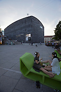 "Vienna. MuseumsQuartier (MQ Vienna) is celebrating its 10th year..People relaxing on ""Enzos"" in front of the MUMOK."