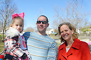 North Merrick, New York, USA. March 31, 2018. R-L, Nassau County Executive LAURA CURRAN poses with ROBERT SCHMID and his daughter BRIDGET SCHMID, 2, of Merrick, at the Annual Eggstravaganza, held at Fraser Park and hosted by North and Central Merrick Civic Association (NCMCA) and Merrick's American Legion Auxiliary Unit 1282.