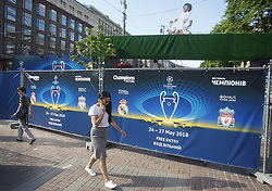 May 23, 2018 - Kiev, Ukraine - People walk past the site of the 2018 UEFA Champions League Final fan zone in central in Kiev, Ukraine, 23 May, 2018. Kiev is preparing for the 2018 UEFA Champions League Final football match between Real Madrid and Liverpool FC next May 26 at the Olimpiyskiy Stadium. (Credit Image: © Str/NurPhoto via ZUMA Press)