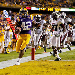 November 13, 2010; Baton Rouge, LA, USA; LSU Tigers running back Michael Ford (42) runs for a touchdown during the second  half against the Louisiana Monroe Warhawks at Tiger Stadium. LSU defeated Louisiana-Monroe 51-0.  Mandatory Credit: Derick E. Hingle