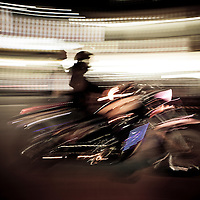 Driving motorcycle at night, French Quarter, Hanoi, Vietnam