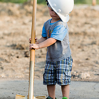 Cal Wynveen, 2, helps out as best as he can at the groundbreaking ceremony for the new St. Charles Police Department headquarters at 1515 W. Main St. in St. Charles on Monday, July 23, 2018.