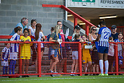 Victoria Williams (Brighton) signing autographs and talking with young supporters following the FA Women's Super League match between Brighton and Hove Albion Women and Chelsea at The People's Pension Stadium, Crawley, England on 15 September 2019.