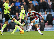 Burnley striker Andre Gray (7) shoots during the Sky Bet Championship match between Burnley and Brighton and Hove Albion at Turf Moor, Burnley, England on 22 November 2015.