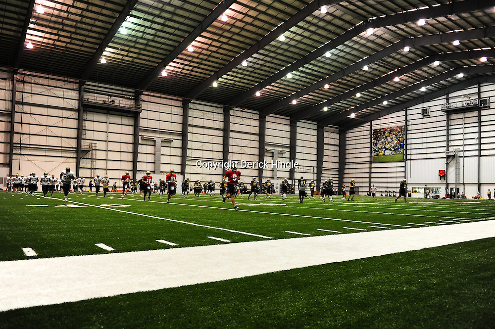 July 30, 2010; Metairie, LA, USA; New Orleans Saints quarterback Drew Brees (9) runs with teammates during a training camp practice at the New Orleans Saints indoor practice facility. Mandatory Credit: Derick E. Hingle