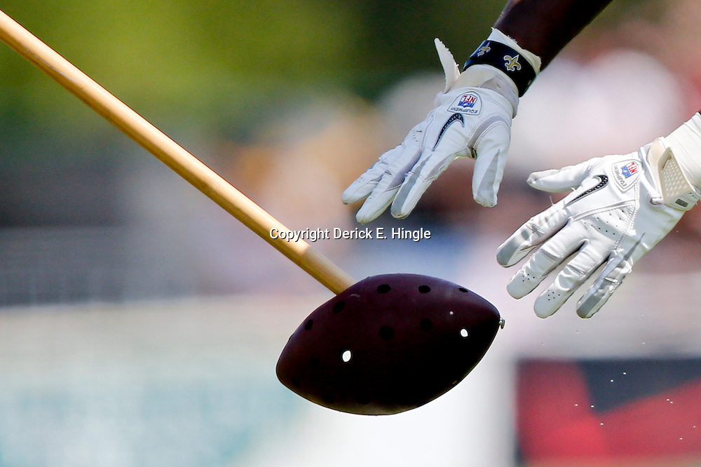 Jul 29, 2013; Metairie, LA, USA; A detail of the hands of New Orleans Saints running back Travaris Cadet (39) working on a special teams drill during a morning training camp practice at the team facility.  Mandatory Credit: Derick E. Hingle-USA TODAY Sports