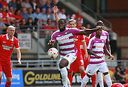 Barnet striker, John Akinde looks to control the ball during the Sky Bet League 2 match between Leyton Orient and Barnet at the Matchroom Stadium, London, England on 8 August 2015. Photo by Bennett Dean.