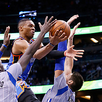 30 October 2015: Oklahoma City Thunder guard Russell Westbrook (0) goes for the layup over Orlando Magic guard Victor Oladipo (5) and Orlando Magic center Nikola Vucevic (9) during the Oklahoma City Thunder 139-136 double overtime victory over the Orlando Magic, at the Amway Center, in Orlando, Florida, USA.