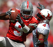 MORNING JOURNAL/DAVID RICHARD<br />Ohio State cornerback Donte Whitner, left, intercepts a pass in front of Josh Williams of Miami yesterday in the second quarter. Whitner returned the play for a 26-yard touchdown.
