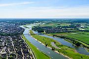 Nederland, Gelderland / Overijssel, Deventer, 17-07-2017; IJssel met uiterwaarden met spoorbrug, ter hoogte van de Ossenwaard. Om het IJsselwater bij hoogwater sneller af te voeren zijn bij Deventer zijn in het kader van het programma Ruimte voor de Rivier de uitwaarden vergraven om een hoogwatergeul te cre&euml;ren. Foto stroomopwaarts.<br /> NOOT: Zie ook opnames van de oorspronkelijke situatie.<br /> IJssel with floodplains. In order to facilitate the flood of water from river IJssel at high waters, floodplains have been has excavated and and a flood chanel has been created.<br /> See also recordings of the original situation.<br /> luchtfoto (toeslag op standard tarieven);<br /> aerial photo (additional fee required);<br /> copyright foto/photo Siebe Swart