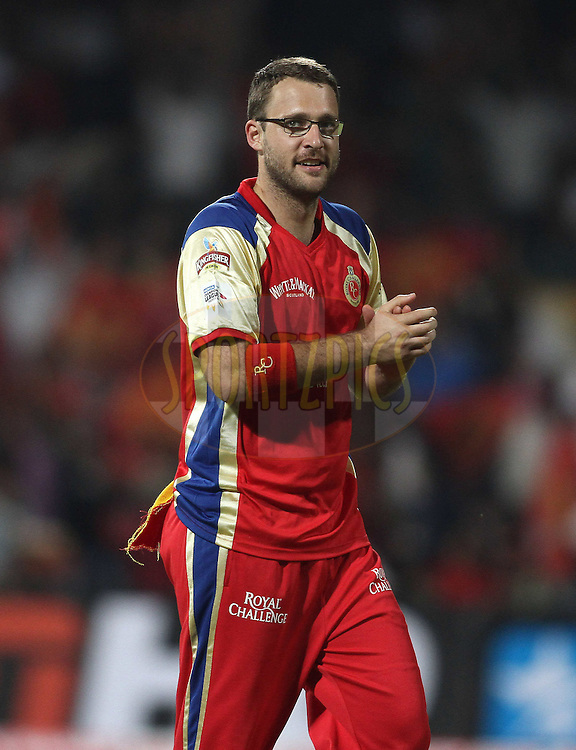 Daniel Vettori of Royal Challengers Bangalore celebrates a wicket during match 1 of the NOKIA Champions League T20 ( CLT20 )between the Royal Challengers Bangalore and the Warriors held at the  M.Chinnaswamy Stadium in Bangalore , Karnataka, India on the 23rd September 2011..Photo by Shaun Roy/BCCI/SPORTZPICS