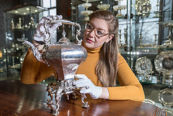 The Bonham's Home & Interiors Sale takes place on 21-22 February and features  a wide array of silver and porcelain.<br /> <br /> Pictured: Jaine Heggie of Bonhams with a rococo revival tea kettle and stand