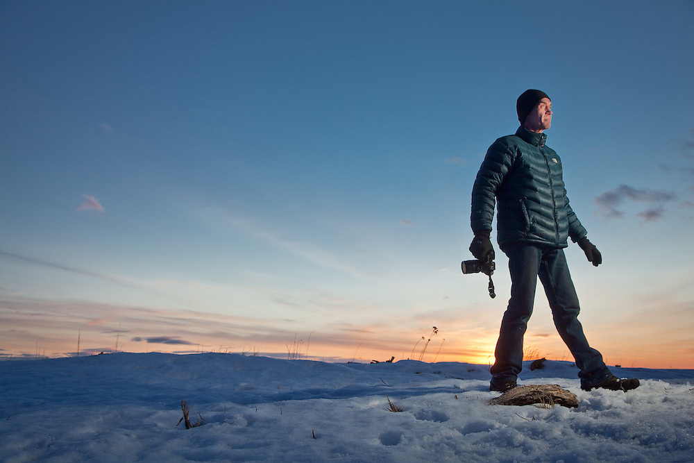 Heavy equipment operator and avid photographer, Daniel Christianson, near Point Woronzof, minutes before sunset on winter solstice, Anchorage, Alaska