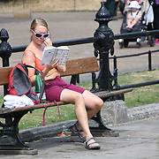 UK Weather: People reading book at Italian garden in Hype park as heatwave continues in London, UK. July 26 2018.