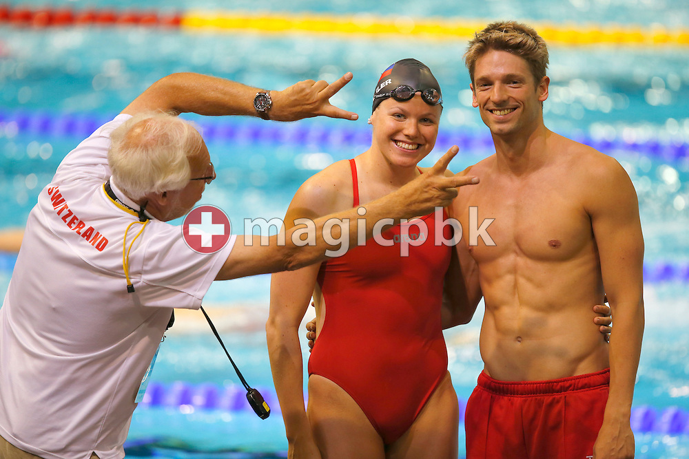 (L-R) Flemming POULSEN photobombs Julia HASSLER of Liechtenstein and Martin SCHWEIZER of Switzerland while they are pictured during a training session prior to the LEN European Swimming Championships at Europa-Sportpark in Berlin, Germany, Sunday, Aug. 17, 2014. (Photo by Patrick B. Kraemer / MAGICPBK)