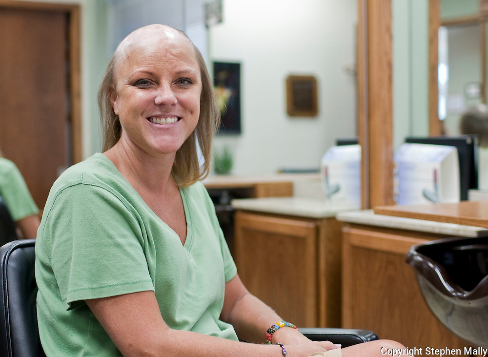 Gina Judkins before receiving her hair piece at Advanced Hair Technologies in Hiawatha on Saturday, May 29, 2010. Judkins was given 6 months to live after being diagnosed with brain cancer. After 6 surgeries, chemotherapy and radiation she has been cancer free for 14 years.