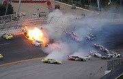 Apr 25, 2010; Talladega, AL, USA; NASCAR Nationwide Series driver Dennis Setzer (92) bursts into flames as he crashes with Paul Menard (98), Brian Vickers (32), Justin Allgaier (12), Scott Wimmer (27), Eric McClure (24) and several others in turn four on the last lap during the Aarons 312 at the Talladega Superspeedway. Mandatory Credit: Mark J. Rebilas-US PRESSWIRE *** UK ONLY ***