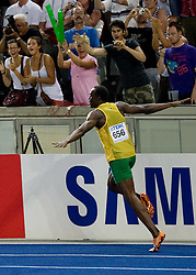 Usain Bolt of Jamaica celebrates winning the gold medal in the men's 100 Metres Final during day two of the 12th IAAF World Athletics Championships at the Olympic Stadium on August 16, 2009 in Berlin, Germany. Bolt set a new World Record of 9.58. (Photo by Vid Ponikvar / Sportida)