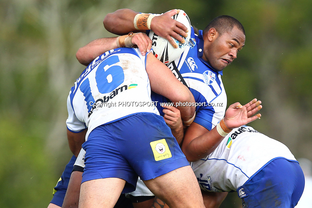 Ukuma Ta'ai is tackled during a NSW Cup rugby league game, Auckland Vulcans v Canterbury Bankstown Bulldogs, Birkenhead War Memorial, Auckland, New Zealand. Saturday 19 May, 2012. Photo: Wayne Drought / photosport.co.nz