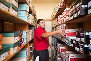 Beck's Shoes store manager Mark Coutreras finds multiple pairs of similar shoes to recommend to customers with specific shoes requirements in Milpitas, Calif., on Sept. 18, 2012.  Photo by Stan Olszewski/SOSKIphoto.