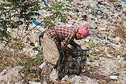 "25 FEBRUARY 2008 -- MAE SOT, TAK, THAILAND: Burmese migrant workers go through garbage in the dump in Mae Sot, Thailand. Hundreds of Burmese migrants eke out a living in the dump going through the garbage to sell what they find. There are millions of Burmese migrant workers and refugees living in Thailand. Many live in refugee camps along the Thai-Burma (Myanmar) border, but most live in Thailand as illegal immigrants. They don't have papers and can not live, work or travel in Thailand but they do so ""under the radar"" by either avoiding Thai officials or paying bribes to stay in the country. Most have fled political persecution in Burma but many are simply in search of a better life and greater economic opportunity.  Photo by Jack Kurtz/ZUMA Press"