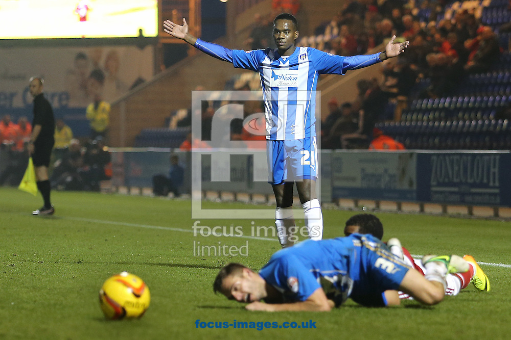 Picture by Richard Calver/Focus Images Ltd +447792 981244<br /> 16/11/2013<br /> Gavin Massey of Colchester United appeals for a foul against team mate, Ryan Dickinson during the Sky Bet League 1 match against Swindon Town at the Weston Homes Community Stadium, Colchester.