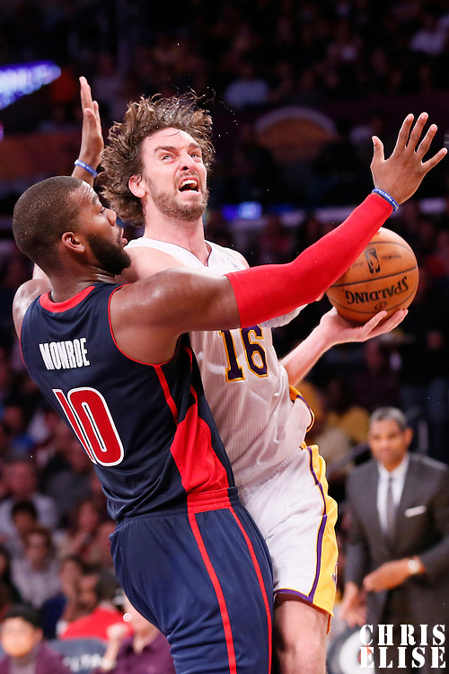 17 November 2013: Los Angeles Lakers center Pau Gasol (16) divers past Detroit Pistons center Andre Drummond (0) during the Los Angeles Lakers 114-99 victory over the Detroit Pistons at the Staples Center, Los Angeles, California, USA.