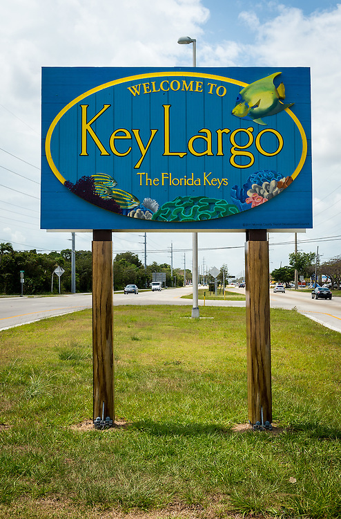 KEY LARGO, FL - CIRCA 2012: Welcome sign over the US1 in Key Largo circa 2012. The Florida Keys are a very popular tourist destination with over 2 million yearly visitors.