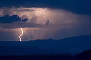 Large lightning bolt from thunderstorm over the New Mexico landscape east of the Sandia mountains, © 2014 David A. Ponton