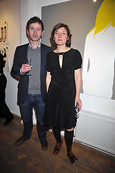 Artist NATASHA LAW and FINTAN RYAN at a private view entitled 'No Love Lost' by artists Daisy de Villeneuve and Natasha Law held at Eleven, 11 Eccleston Street, London SW1 on 31st March 2009.