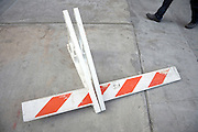 fallen over sawhorse on the sidewalk