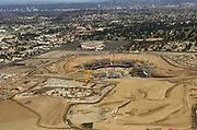 General overall aerial view of L.A. Stadium and Entertainment District at Hollywood Park under construction with the Forum in the background on Friday, Dec. 15, 2017 in Inglewood, Calif. The venue, privately financed by Los Angeles Rams owner Stan Kroenke, is scheduled to open in 2020. It will be the home to the Rams and the Los Angeles Chargers and will play host to Super Bowl LVI in 2022. IIt will also play host to the opening and closing ceremonies for the Los Angeles 2028 Olympics.