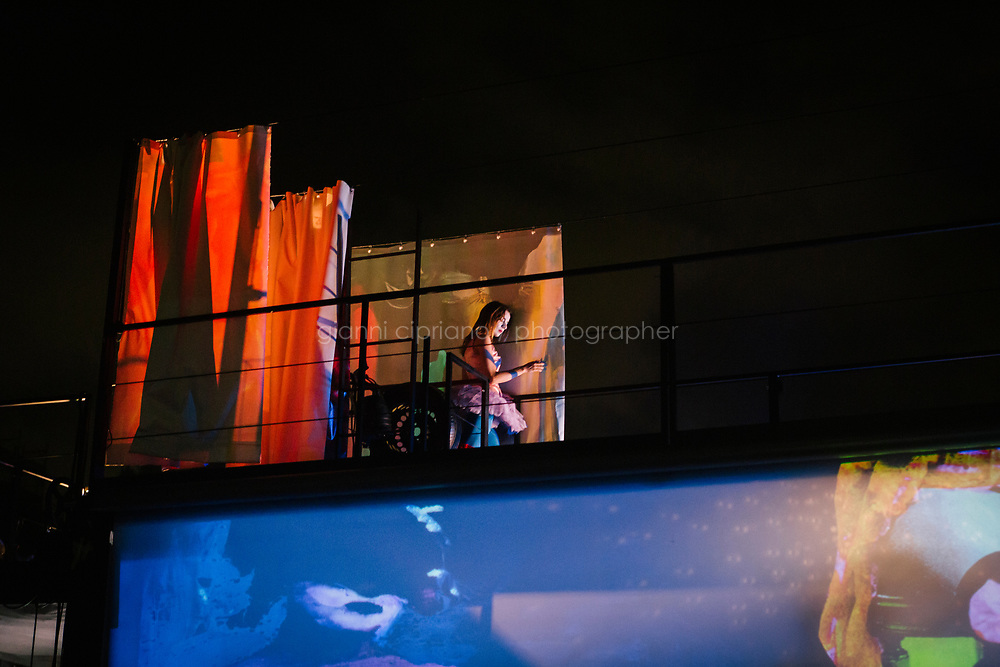 ROME, ITALY - 27 JUNE 2017: Actresss Vittoria Faro is seen here backstage before going on stage to perform for the  &quot;Don Giovanni OperaCamion&quot;, an open-air opera performed on a truck in San Basilio, a suburb in Rome, Italy, on June 27th 2017.<br /> <br /> Director Fabio Cherstich&rsquo;s idae of an &ldquo;opera truck&rdquo; was conceived as a way of bringing the musical theatre to a new, mixed, non elitist public, and have it perceived as a moment of cultural sharing, intelligent entertainment and no longer as an inaccessible and costly event. The truck becomes a stage that goes from square to square with its orchestra and its company of singers in Rome. <br /> <br /> &ldquo;Don Giovanni Opera Camion&rdquo;, after &ldquo;Don Giovanni&rdquo; by Wolfgang Amadeus Mozart is a new production by the Teatro dell&rsquo;Opera di Roma, conceived and directed by Fabio Cherstich. Set, videos and costumes by Gianluigi Toccafondo. The Youth Orchestra of the Teatro dell&rsquo;Opera di Roma is conducted by Carlo Donadio.