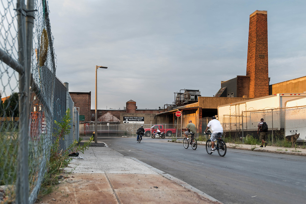 Taken Saturday, August 8th, 2015 from 7:25-7:46PM. Found and &copy; by Mike Ritter.<br /> <br /> Norfolk Ave. intersects with Gerard St. in the distance and runs parallel to Mass Ave through an old industrial area of Roxbury. A city dump is just up Gerard St. on the left from this vantage point. There aren&rsquo;t many pedestrians or much traffic here. I was surprised to learn that the menacing guard dog who occasionally chased me along the fence of the junkyard as I biked by late at night between my South End studio and Dorchester home, was actually white faced and arthritic.