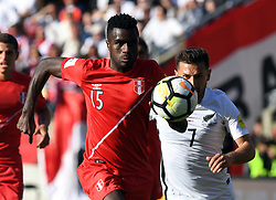Peru's Christain Ramos, left and New Zealand's Kosta Barbarouses chase down the ball in the Soccer World Cup qualifying match, Westpac Stadium, Wellington, New Zealand, Saturday, November 11, 2017. Credit:SNPA / Ross Setford  **NO ARCHIVING**