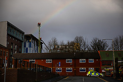 "© Licensed to London News Pictures. 16/11/2019. Bolton, UK. A rainbow is seen over The Cube as firefighters work at the scene where a fire broke out overnight (15th/16th November 2019) at a block of flats known as "" The Cube "" , in Bolton Town Centre . At least two people are known to have been treated by paramedics at the scene of the six-story , block which is occupied by students of the University of Bolton . Photo credit: Joel Goodman/LNP"