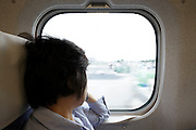 looking out the window of a fast traveling shinkansen train