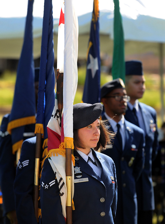 jt052917e/ a sec/jim thompson/Airman 1st Class  Analise Sena stand at attention as Air Force service members from KAFB  prepare to present the state flags at the Memorial Day Ceremony held at the New Mexico Veteran's Memorial. Monday May. 29, 2017. (Jim Thompson/Albuquerque Journal)