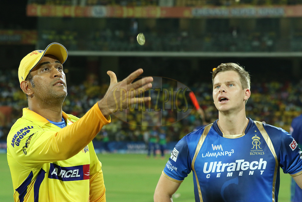 CSK captain Dhoni fliping the coin and RR captain Steve Smith(R) call for it during match 47 of the Pepsi IPL 2015 (Indian Premier League) between The Chennai Superkings and The Rajasthan Royals held at the M. A. Chidambaram Stadium, Chennai Stadium in Chennai, India on the 10th May 2015.<br /> <br /> Photo by:  Saikat Das / SPORTZPICS / IPL