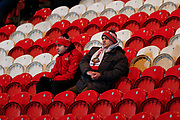 Doncaster Rovers fans watch the their team warming up before the EFL Sky Bet League 1 match between Doncaster Rovers and Bristol Rovers at the Keepmoat Stadium, Doncaster, England on 26 March 2019.